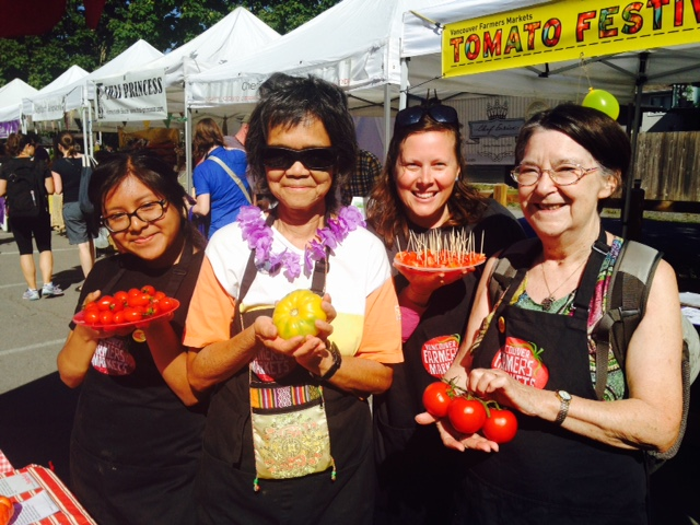 Tomato Fest volunteers displayed and samples so many tomatoes! Get them while they're ripe!